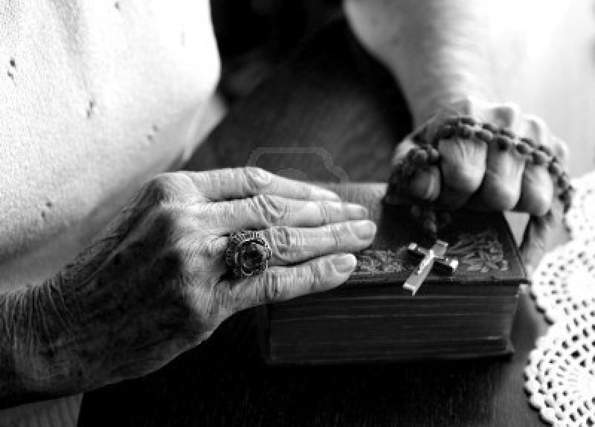 1215992-elderly-woman-s-hands-holding-her-bible-and-rosary